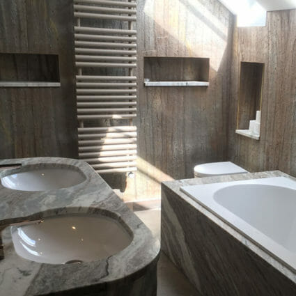 Marble & Stone Bathroom with Metal Fittings