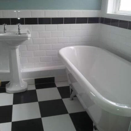 Art Deco Inspired Bathroom with Traditional Tiles & Rolltop Bath